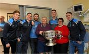 25 December 2017; Michael Fitzsimons, Dublin captain Stephen Cluxton, Jack McCaffrey, Brian Fenton and Cormac Costellowith patient Vincent Callaghan, from Finabans, Co Donegal, and his wife Patricia, herself a former Mayor of Donegal Town, and the Sam Maguire Cup during the Dublin Football team visit to Beaumont Hospital in Dublin. Photo by Ray McManus/Sportsfile
