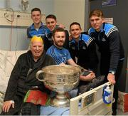 25 December 2017; Dublin captain Stephen Cluxton, Jack McCaffrey, Brian Fenton and Cormac Costello with patient Leo Raffrerty, from Coolock, Dublin, and the Sam Maguire Cup during the Dublin Football team visit to Beaumont Hospital in Dublin. Photo by Ray McManus/Sportsfile