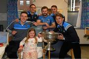 25 December 2017; Dublin captain Stephen Cluxton, Jack McCaffrey, Brian Fenton, Cormac Costello, Michael Fitzsimons, with patient Mischa Fahy, eight years, from, Turloughmore, Co Galway and the Sam Maguire during the Dublin Football team visit to Beaumont Hospital in Dublin. Photo by Ray McManus/Sportsfile