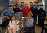 25 December 2017; Dublin captain Stephen Cluxton, Jack McCaffrey, Brian Fenton, Cormac Costello, Michael Fitzsimons, with patient Mischa Fahy, eight years, from, Turloughmore, Co Galway, her mother Liz and dad Roger and the Sam Maguire during the Dublin Football team visit to Beaumont Hospital in Dublin. Photo by Ray McManus/Sportsfile