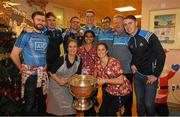 25 December 2017; Jack McCaffrey, Michael Fitzsimons, captain Stephen Cluxton, Brian Fenton,  Dr Diarmuid Smyth, selector Shane O'Hanlon and Cormac Costello, with staff Linda Bradley, Alphonsa George and Cathy Coyne and the Sam Maguire Cup during the Dublin Football team visit to Beaumont Hospital in Dublin. Photo by Ray McManus/Sportsfile