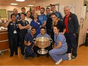 25 December 2017; Jack McCaffrey, Michael Fitzsimons, captain Stephen Cluxton, Brian Fenton and Cormac Costello with staff on duty in the A and E department and the Sam Maguire Cup during the Dublin Football team visit to Beaumont Hospital in Dublin. Photo by Ray McManus/Sportsfile