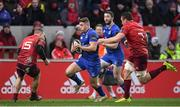 26 December 2017; Jordan Larmour of Leinster in action against Andrew Conway, left, and Tommy O'Donnell of Munster during the Guinness PRO14 Round 11 match between Munster and Leinster at Thomond Park in Limerick. Photo by Brendan Moran/Sportsfile