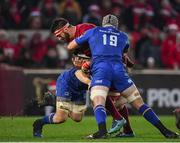 26 December 2017; Jean Kleyn of Munster is tackled by Jack Conan and Mick Kearney of Leinster during the Guinness PRO14 Round 11 match between Munster and Leinster at Thomond Park in Limerick. Photo by Brendan Moran/Sportsfile
