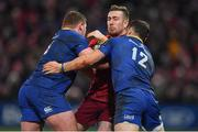 26 December 2017; JJ Hanrahan of Munster is tackled by Tadhg Furlong, left, and Robbie Henshaw of Leinster during the Guinness PRO14 Round 11 match between Munster and Leinster at Thomond Park in Limerick. Photo by Brendan Moran/Sportsfile