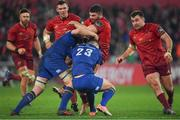 26 December 2017; Sammy Arnold of Munster is tackled by Dan Leavy and Noel Reid of Leinster during the Guinness PRO14 Round 11 match between Munster and Leinster at Thomond Park in Limerick. Photo by Brendan Moran/Sportsfile