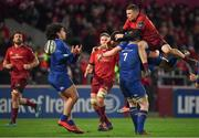 26 December 2017; Andrew Conway of Munster competes for a high ball with Leinster players, from left, James Lowe, Noel Reid and Dan Leavy during the Guinness PRO14 Round 11 match between Munster and Leinster at Thomond Park in Limerick. Photo by Brendan Moran/Sportsfile