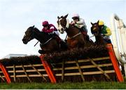 28 December 2017; Hardback, left, with Shane Shortall up, jumps the last alongside Low Sun, right, with Paul Townend up, on their way to winning the Irish Daily Star Christmas Novice Handicap Hurdle on day 3 of the Leopardstown Christmas Festival at Leopardstown in Dublin. Photo by Seb Daly/Sportsfile