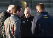 7 January 2018; Derry manager Damian McErlain, centre, on the pitch after the posponement of the Bank of Ireland Dr. McKenna Cup Section B Round 2 match between Armagh and Derry at the Athletic Grounds in Armagh. Photo by Oliver McVeigh/Sportsfile