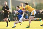 7 January 2018; Conor Bradley of Cavan is tackled by Kevin O'Boyle of Antrim during the Bank of Ireland Dr. McKenna Cup Section A Round 2 match between Antrim and Cavan at Woodlands Playing Fields in Belfast. Photo by Ramsey Cardy/Sportsfile
