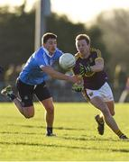 7 January 2018; Tiernan Rossiter of Wexford in action against Colm Basquel of Dublin during the Bord na Mona O'Byrne Cup Group 1 Third Round match between Wexford and Dublin at St. Patricks Park in Wexford. Photo by Matt Browne/Sportsfile