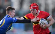 10 January 2018; Niall Scully of CBC Monkstown in action against Jeremiah Obienkwe of Wilson's Hospital during the Bank of Ireland Leinster Schools Vinnie Murray Cup Round 1 match between Wilson's Hospital and CBC Monkstown at Donnybrook Stadium in Dublin. Photo by Eóin Noonan/Sportsfile