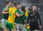 10 January 2018; Fermanagh and Donegal players in dispute as Referee Padraig Hughes looks on during the Bank of Ireland Dr. McKenna Cup Section C Round 3 match between Donegal and Fermanagh at Páirc MacCumhaill in Ballybofey, Donegal. Photo by Oliver McVeigh/Sportsfile