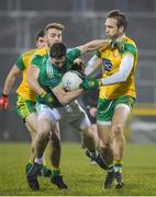 10 January 2018; Eoin Donnelly of Fermanagh in action against Stephen McMenamin, left, and Nathan Mullins of Donegal during the Bank of Ireland Dr. McKenna Cup Section C Round 3 match between Donegal and Fermanagh at Páirc MacCumhaill in Ballybofey, Donegal. Photo by Oliver McVeigh/Sportsfile