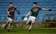 12 January 2018; Peter Naughton of Mayo scores his side's first goal as Johnny Duane of Galway looks on during the Connacht FBD League Round 2 refixture match between Mayo and Galway at Elverys MacHale Park in Castlebar, Mayo. Photo by Piaras Ó Mídheach/Sportsfile