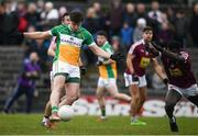 14 January 2018; Joseph O'Connor of Offaly shoots to score his side's first goal despite the efforts of Boidu Sayeh of Westmeath during the Bord na Mona O'Byrne Cup semi-final match between Westmeath and Offaly at Cusack Park, in Mullingar, Westmeath. Photo by Sam Barnes/Sportsfile