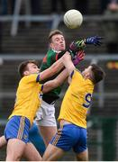 14 January 2018; Danny Kirby of Mayo in action against Enda Smith and Ian Kilbride, right,  of Roscommon during the Connacht FBD League Round 4 match between Roscommon and Mayo at Dr Hyde Park in Roscommon. Photo by Piaras Ó Mídheach/Sportsfile
