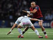 14 January 2018; Simon Zebo of Munster is tackled by Maxime Machenaud of Racing 92 during the European Rugby Champions Cup Pool 4 Round 5 match between Racing 92 and Munster at the U Arena in Paris, France. Photo by Brendan Moran/Sportsfile