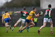 14 January 2018; Enda Smith of Roscommon, supported by team-mate Niall McInerney in action against Eoin O'Donoghue and Stephen Coen, right, of Mayo during the Connacht FBD League Round 4 match between Roscommon and Mayo at Dr Hyde Park in Roscommon. Photo by Piaras Ó Mídheach/Sportsfile