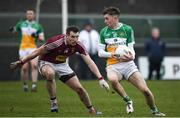 14 January 2018; Cian Johnson of Offaly in action against Kieran Martin of Westmeath during the Bord na Mona O'Byrne Cup semi-final match between Westmeath and Offaly at Cusack Park, in Mullingar, Westmeath. Photo by Sam Barnes/Sportsfile