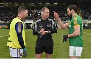 14 January 2018; Referee Darragh Sheppard with captains Michael Quinn of Longford, left, and Graham Reilly of Meath prior to the Bord na Mona O'Byrne Cup semi-final match between Meath and Longford at Páirc Táilteann in Navan, Meath. Photo by Seb Daly/Sportsfile