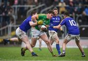 14 January 2018; Harry Rooney of Meath in action against Andrew Farrell, left, and Barry McKeon of Longford during the Bord na Mona O'Byrne Cup semi-final match between Meath and Longford at Páirc Táilteann in Navan, Meath. Photo by Seb Daly/Sportsfile