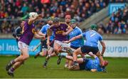 14 January 2018; Jack O'Connor of Wexford breaks away from Tomás Connolly, left, Cian McBride, and Chris Crummey, right, during the Bord na Mona Walsh Cup semi-final match between Dublin and Wexford at Parnell Park in Dublin. Photo by Daire Brennan/Sportsfile
