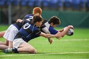 15 January 2018; Joshua O'Hare of Dundalk Grammar School scores a try despite the tackle from Mark Lawless and Theo Connolly of Mount Temple during the Community School Bank of Ireland Leinster Schools Fr. Godfrey Cup Round 1 match between Dundalk Grammar School and Mount Temple at Donnybrook Stadium in Dublin. Photo by Matt Browne/Sportsfile