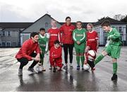 16 January 2018; The SPAR FAI Primary School 5s Programme was launched with a pop up training session at Scoil Mhuire CBS, Dublin, where former Republic of Ireland footballer and past pupil, Keith Andrews and current Republic of Ireland women's footballer, Megan Campbell provided a coaching masterclass to students from Scoil Mhuire CBS and St Vincent de Paul's Girls NS. The five-a-side school blitzes are open to boys and girls from 4th, 5th and 6th class, and puts emphasis on fun and inclusivity. Register for the SPAR5s by February 9th at www.fai.ie/primary5. Pictured is Scoil Mhuire CBS pupil Paddy Stanley, age 10, right, as he shows of his skills to former Republic of Ireland footballer and past pupil, Keith Andrews, left, at Scoil Mhuire CBS, Clontarf, Dublin. Photo by Seb Daly/Sportsfile
