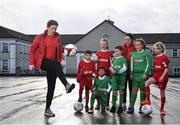 16 January 2018; The SPAR FAI Primary School 5s Programme was launched with a pop up training session at Scoil Mhuire CBS, Dublin, where former Republic of Ireland footballer and past pupil, Keith Andrews and current Republic of Ireland women's footballer, Megan Campbell provided a coaching masterclass to students from Scoil Mhuire CBS and St Vincent de Paul's Girls NS. The five-a-side school blitzes are open to boys and girls from 4th, 5th and 6th class, and puts emphasis on fun and inclusivity. Register for the SPAR5s by February 9th at www.fai.ie/primary5. Pictured is former Republic of Ireland footballer and past pupil of Scoil Mhuire CBS, Keith Andrews, left, as he shows of his skills, to current pupils of Scoil Mhuire CBS and St Vincent de Paul's Girls NS, at Scoil Mhuire CBS, Clontarf, Dublin. Photo by Seb Daly/Sportsfile