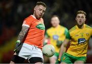 20 January 2018; Eamon McGeown of Armagh in action against Stephen McMenamin of Donegal during the Bank of Ireland Dr. McKenna Cup semi-final match between Donegal and Armagh at Celtic Park in Derry. Photo by Oliver McVeigh/Sportsfile
