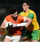 20 January 2018; Aaron Findon of Armagh in action against Jason McGee of Donegal during the Bank of Ireland Dr. McKenna Cup semi-final match between Donegal and Armagh at Celtic Park in Derry. Photo by Oliver McVeigh/Sportsfile