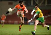 20 January 2018; Aaron Findon of Armagh has his shot blockd down by Jason McGee of Donegal during the Bank of Ireland Dr. McKenna Cup semi-final match between Donegal and Armagh at Celtic Park in Derry. Photo by Oliver McVeigh/Sportsfile