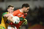 20 January 2018; Oisin MacIomhair of Armagh in action against Eoghan Ban Gallagher of Donegal during the Bank of Ireland Dr. McKenna Cup semi-final match between Donegal and Armagh at Celtic Park in Derry. Photo by Oliver McVeigh/Sportsfile