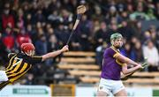 20 January 2018; Conor McDonald of Wexford scores a late point despite the effort from Cillian Buckley of Kilkenny to block it during the Bord na Mona Walsh Cup Final match between Kilkenny and Wexford at Nowlan Park in Kilkenny. Photo by Matt Browne/Sportsfile