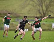 21 January 2018; Finnian Cawley of Sligo in action against Stephen Coen of Mayo during the Connacht FBD League Round 5 match between Sligo and Mayo at James Stephen's Park in Ballina, Co Mayo. Photo by Seb Daly/Sportsfile