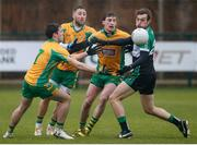 21 January 2018; Ian Nolan of Fulham Irish in action against Dylan Wall, left, Michael Lundy, centre, and Ronan Steede of Fulham Irish during the AIB GAA Football All-Ireland Senior Club Championship Quarter-Final Refixture match between Fulham Irish and Corofin at McGovern Park in Ruislip, England. Photo by Matt Impey/Sportsfile