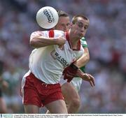 3 August 2003; Barry McGuigan, Tyrone, in action against Fermanagh's Kieran Gallagher. Bank of Ireland All-Ireland Senior Football Championship Quarter Final, Tyrone v Fermanagh, Croke Park, Dublin. Picture credit; Ray McManus / SPORTSFILE *EDI*