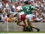 3 August 2003; Peter Canavan, Tyrone, in action against Fermanagh's Ryan McCloskey. Bank of Ireland All-Ireland Senior Football Championship Quarter Final, Tyrone v Fermanagh, Croke Park, Dublin. Picture credit; Brendan Moran / SPORTSFILE *EDI*