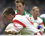 3 August 2003; Ryan McMenamin, Tyrone, in action against Fermanagh's Raymond Gallagher. Bank of Ireland All-Ireland Senior Football Championship Quarter Final, Tyrone v Fermanagh, Croke Park, Dublin. Picture credit; Ray McManus / SPORTSFILE *EDI*