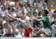 3 August 2003; Brian McGuigan, Tyrone, in action against Fermanagh's Michael Lilley. Bank of Ireland All-Ireland Senior Football Championship Quarter Final, Tyrone v Fermanagh, Croke Park, Dublin. Picture credit; Brendan Moran / SPORTSFILE *EDI*