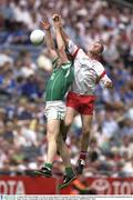 3 August 2003; Kevin Hughes, Tyrone, in action against Fermanagh's Paul Brewster. Bank of Ireland All-Ireland Senior Football Championship Quarter Final, Tyrone v Fermanagh, Croke Park, Dublin. Picture credit; Brendan Moran / SPORTSFILE *EDI*