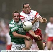 3 August 2003; Brian Dooher, Tyrone, in action against Fermanagh's Martin McGrath. Bank of Ireland All-Ireland Senior Football Championship Quarter Final, Tyrone v Fermanagh, Croke Park, Dublin. Picture credit; Brendan Moran / SPORTSFILE *EDI*