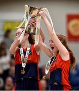 23 January 2018; St Colmcille's Community School joint-captains Hannah Byrne, right, and Emma Mullins lift the trophy following the Subway All-Ireland Schools U16C Girls Cup Final match between Jesus & Mary Gortnor Abbey and St Colmcilles Knocklyon at the National Basketball Arena in Tallaght, Dublin. Photo by David Fitzgerald/Sportsfile