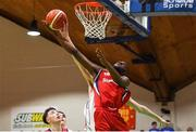 27 January 2018; Aston Kisuka of Templeogue has his shot blocked by David Murray of Neptune during the Hula Hoops Under 18 Men's National Cup Final match between Neptune and Templeogue at the National Basketball Arena in Tallaght, Dublin. Photo by Eóin Noonan/Sportsfile