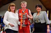 27 January 2018; Templeogue captain Conor Flood is presented with the cup by Margaret Miley, left, NABC Member, and President of Basketball Ireland Theresa Walsh after the Hula Hoops Under 18 Men's National Cup Final match between Neptune and Templeogue at the National Basketball Arena in Tallaght, Dublin. Photo by Brendan Moran/Sportsfile
