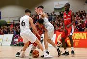 27 January 2018; Kris Arcilla of Templeogue in action against Kelvin O'Donoghue, left and James Hannigan of Neptune during the Hula Hoops Under 18 Men's National Cup Final match between Neptune and Templeogue at the National Basketball Arena in Tallaght, Dublin. Photo by Eóin Noonan/Sportsfile