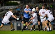 27 January 2018; Bernard Brogan of Dublin passes off under pressure from Kildare's, from left, Peter Kelly, David Hyland, Mick O' Grady and David Slattery during the Allianz Football League Division 1 Round 1 match between Dublin and Kildare at Croke Park in Dublin. Photo by Piaras Ó Mídheach/Sportsfile