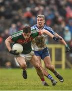 28 January 2018; Neil Douglas of Mayo in action against Ryan Wylie of Monaghan during the Allianz Football League Division 1 Round 1 match between Monaghan and Mayo at St Tiernach's Park in Clones, County Monaghan. Photo by Seb Daly/Sportsfile