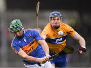 28 January 2018; Cathal Barrett of Tipperary in action against David Fitzgerald of Clare during the Allianz Hurling League Division 1A Round 1 match between Clare and Tipperary at Cusack Park in Ennis, County Clare.  Photo by Stephen McCarthy/Sportsfile